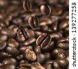 Coffee Beans drop on coffee bean floor - stock photo