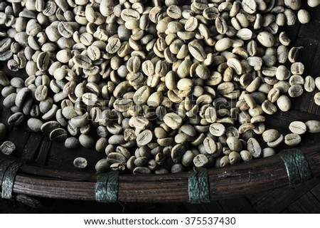 Coffee beans for backgrounds or textures take with selective color technique and art lighting - stock photo