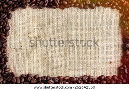 Coffee beans frame on burlap background. Post processed with vintage filter.  - stock photo