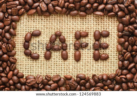 coffee beans frame with cafe text on sacking background