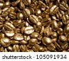 Coffee beans gold closeup background. - stock photo
