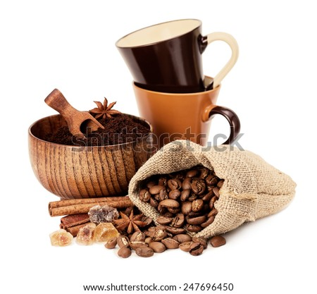 Coffee beans, ground coffee and coffee cups on a white background - stock photo