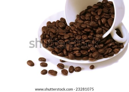 Coffee beans heap in white cup.