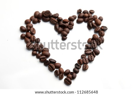 Coffee beans heart isolated on white background - stock photo