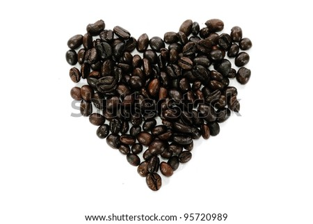 Coffee beans heart on white background - stock photo