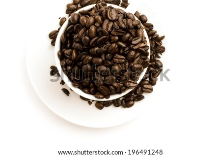 Coffee beans in a bowl that is overflowing. - stock photo