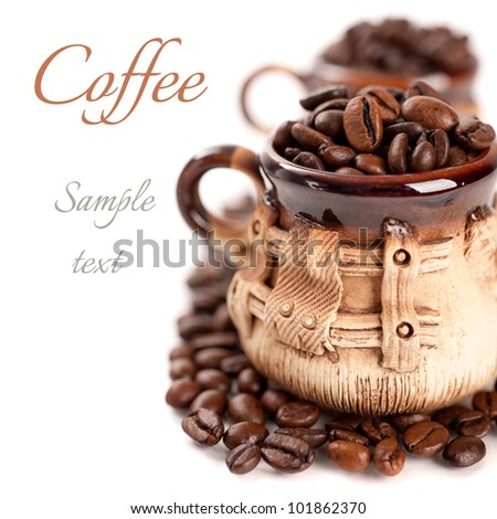 Coffee beans in a cup with the sample text - stock photo