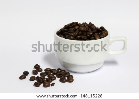 Coffee beans in a cup with white back ground or isolation back ground