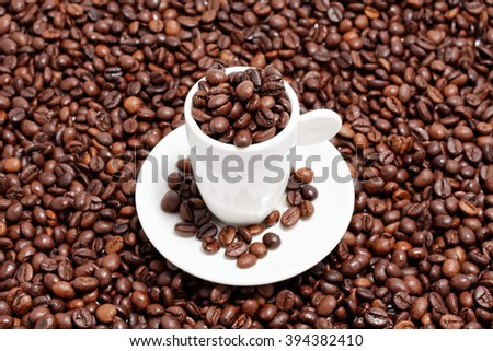 coffee beans in a espresso cup - stock photo