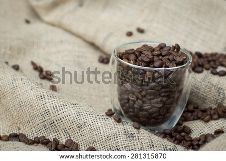 Coffee beans in a glass cup - stock photo