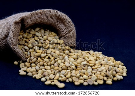 Coffee beans in a sack - stock photo