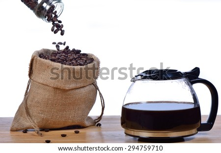 Coffee beans in a sack. - stock photo
