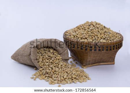 Coffee beans  in a sack and  on wicker  Basket. - stock photo