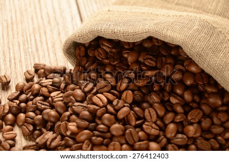 Coffee beans in a sack on the table