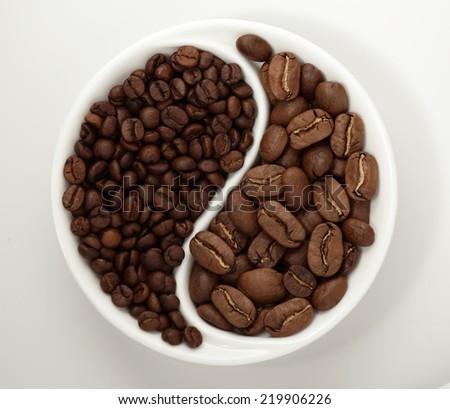 coffee beans white yin yang bowl stock photo royalty free