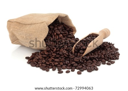 Coffee beans in a wooden scoop and spilling out from a hessian bag  over  white. Coffee Bean Bag Stock Images  Royalty Free Images   Vectors