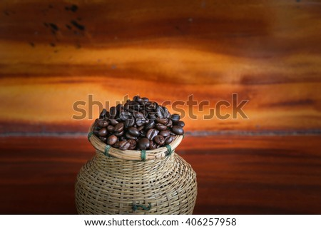 coffee beans in bamboo basket on wood texture