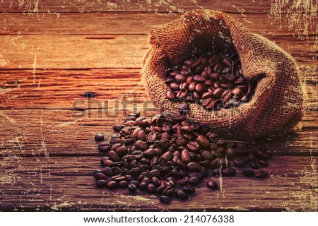 Coffee beans in brown bag. culinary coffee still life. - stock photo