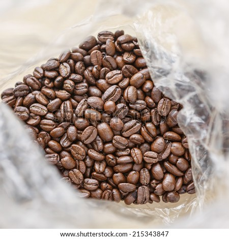Coffee beans in brown bag. culinary coffee still life.