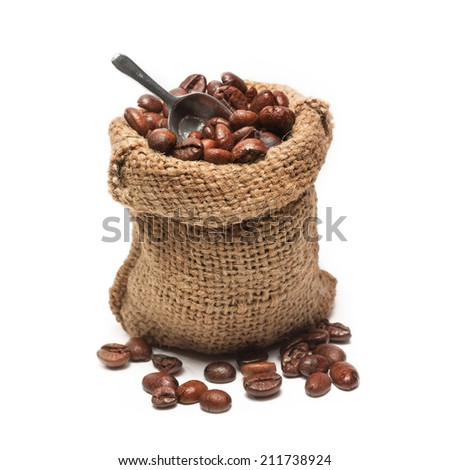 coffee beans in burlap bag, isolated - stock photo