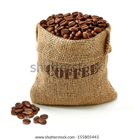 Coffee beans in burlap bag on white background