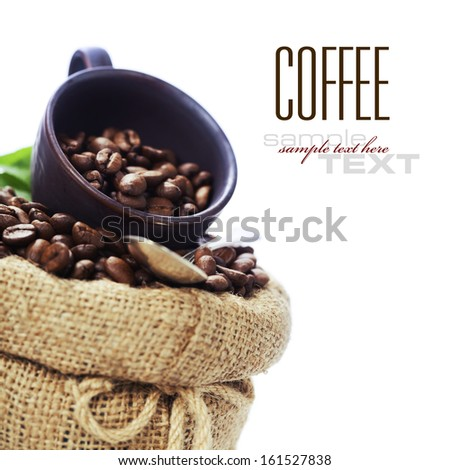 Coffee beans in burlap sack over white (with sample text) - stock photo