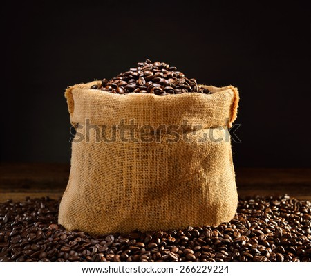 Coffee beans in burlap sack, This photo is available with smoke - stock photo
