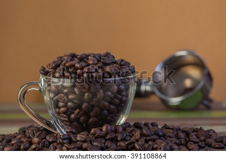 Coffee beans in clear cup - stock photo