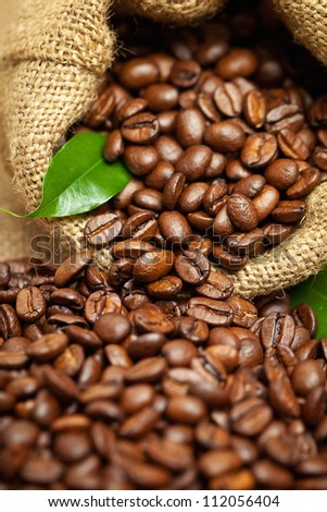 Coffee beans in cloth sack - stock photo