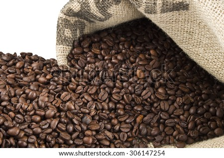 Coffee beans in coffee bag made from burlap on white - stock photo