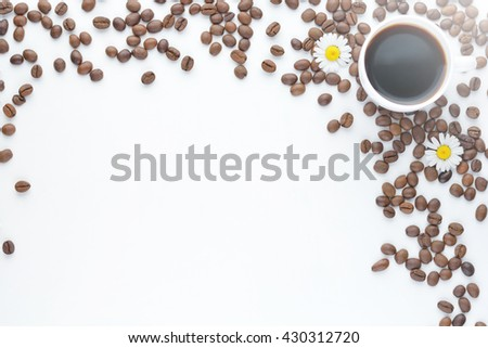 Coffee beans in coffee cup on white. selective focus - stock photo