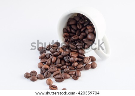 Coffee beans in coffee cup white background