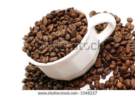 Coffee beans in cup isolated on white background.