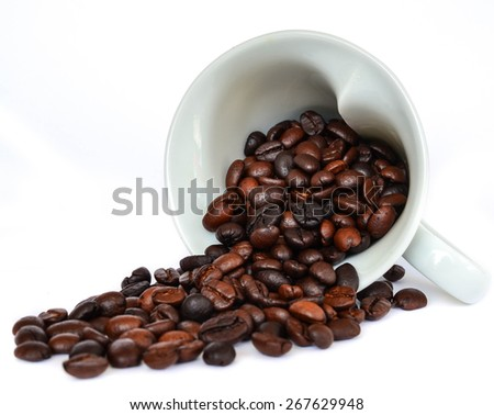 Coffee beans in cup shape of heart