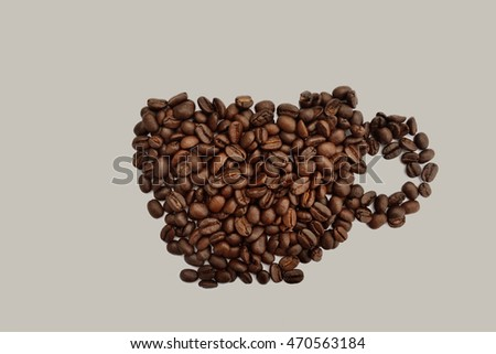coffee beans in cup shape on gray background