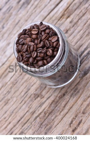 coffee beans in glass jar on the wooden table