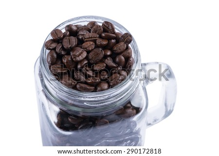 Coffee beans in glass on white background