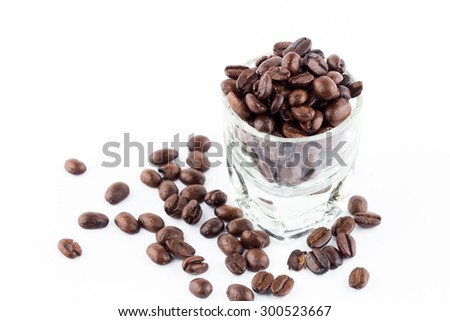 coffee beans in glass on white background Focus in glass