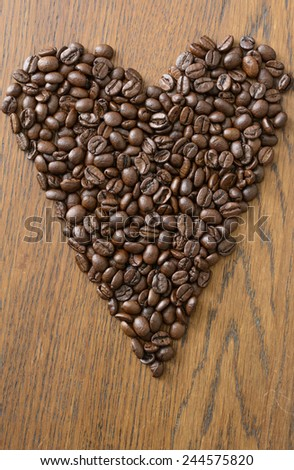 coffee beans in heart shape - stock photo