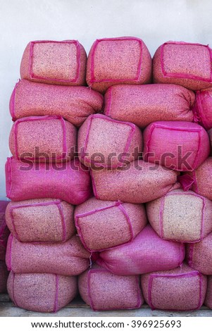 Coffee beans in pink sack bags at storage house