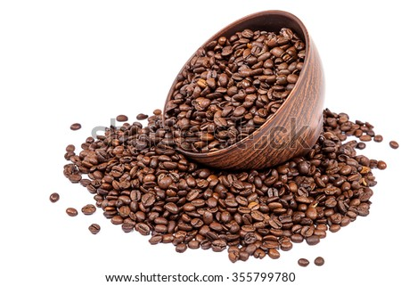 Coffee beans  in pottery isolated on white background. - stock photo
