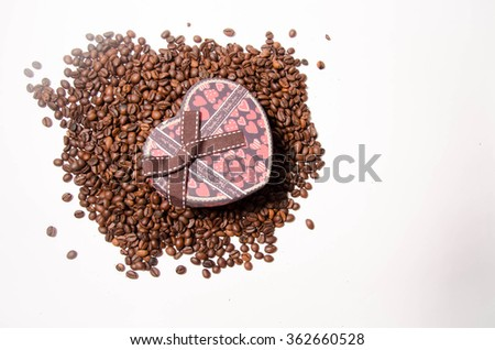 Coffee beans in shape of heart - stock photo