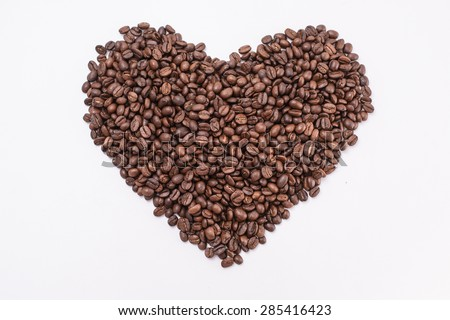 Coffee beans in shape of heart. coffee beans isolated on white background. roasted coffee beans, can be used as a background.