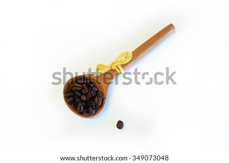 Coffee beans in spoon isolated on white