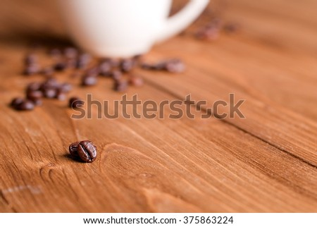 coffee beans in the foreground - stock photo
