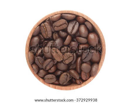 Coffee beans in wooden bowl isolated on white background, top view - stock photo