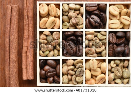 Coffee beans in wooden box and cinnamon