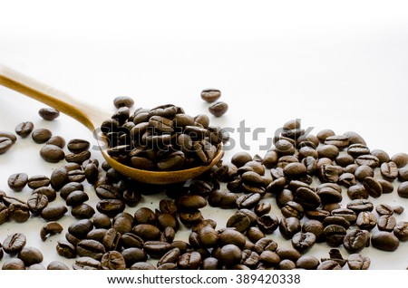 Coffee beans in wooden spoon on white background, Coffee, Aroma, Caffeine, Coffee break, Coffee Wallpaper - stock photo