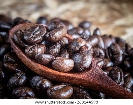 Coffee beans in wooden spoon with filter effect retro vintage style - stock photo