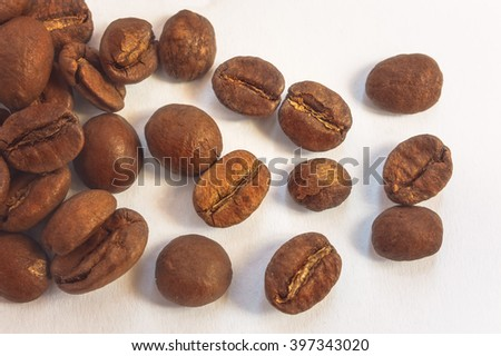Coffee beans isolated on light background. Top of view. Selective focus. - stock photo